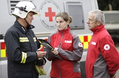 FESS volunteers discuss fire incident with fireman - uk-584-53