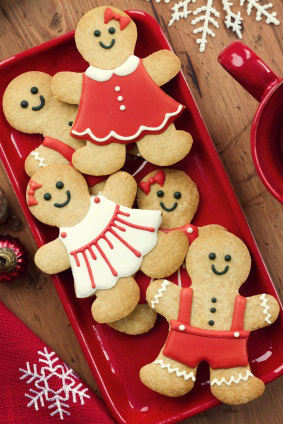 Gingerbread men on a red platter
