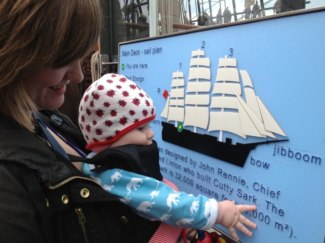 A-family-enjoying-a-Maps-for-All-sail-plan